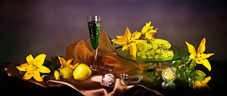 Still life with yellow lily and fresh fruits  photo