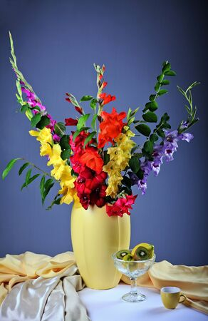 gladiolus: Still life with colorful  gladioluses and fresh fruits