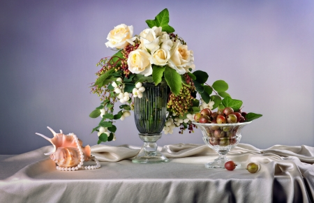 Still life with white roses  and fresh gooseberry photo