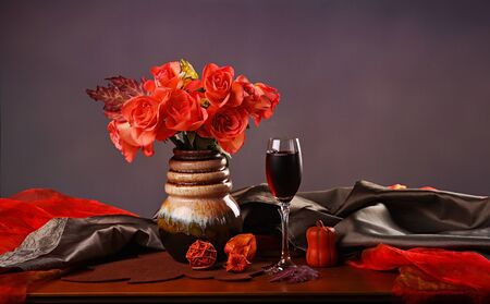 Still life with red wine and roses photo