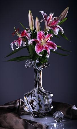 composition: Still life with pink  lily flowers  in a glass vase