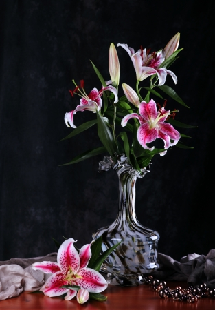 Still life with pink  lily flowers  in a glass vase
