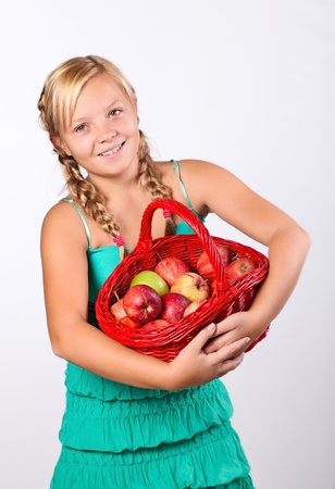Beautiful girl with a basket of   Apples photo