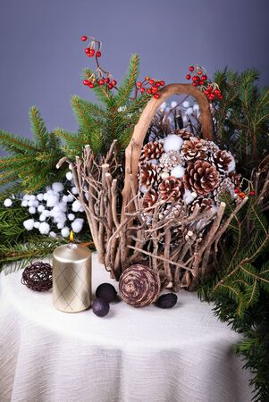 Still life with Pine cones  in  basket and a candle Stock Photo - 16914423