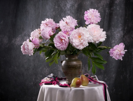 Still life with beautiful pink peonies and fruit Фото со стока