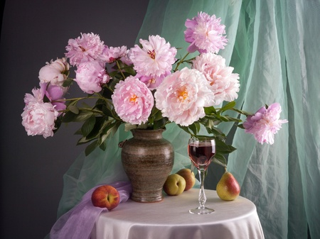 Still life with beautiful pink peonies and fruits