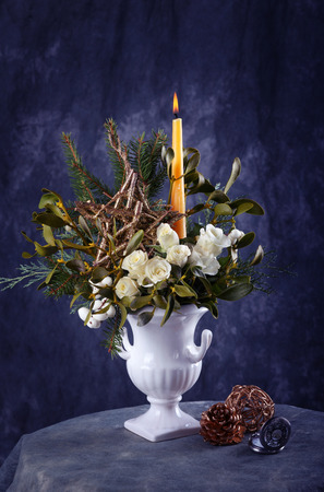 floral arrangements: Still life with white roses and christmas decorations