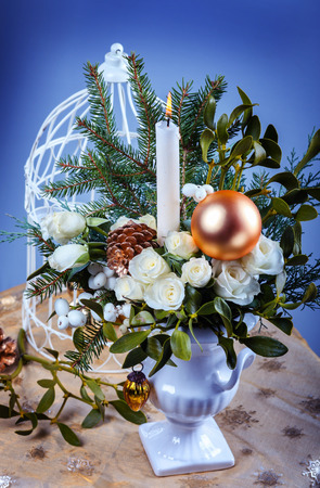 Still life with white roses and christmas decorations photo