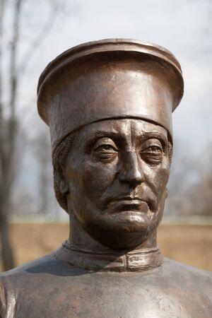 tsarskoye: TSARSKOYE SELO, SAINT-PETERSBURG, RUSSIA - APRIL 6, 2015: The White Tower. The Bronze Sculpture. The Tsarskoye Selo is State Museum. Located near Saint-Petersburg
