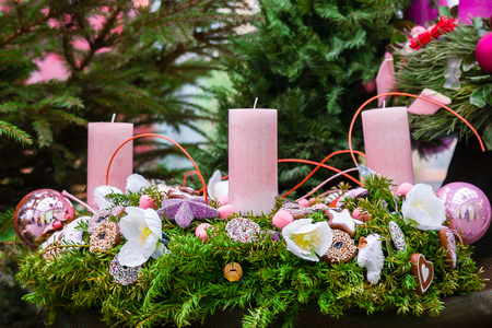 christmas candle: Christmas decoration evergreen wreath decorated with pink candles Stock Photo