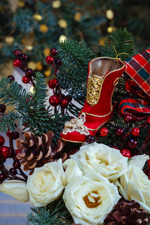 Christmas arrangement of vintage boot toy and flowers Stock Photo