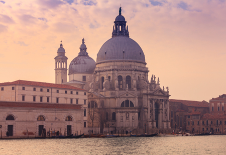 Gorgeous view of the Grand Canal and Basilica Santa Maria della Salute during sunset, Venice, Italy,
