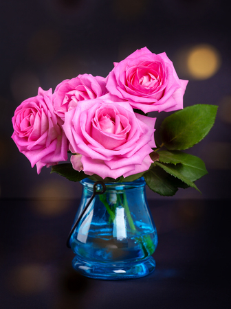 Bouquet of fresh pink roses with bokeh lights 스톡 콘텐츠