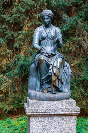 PAVLOVSK, ST PETERSBURG, RUSSIA - AUGUST 28, 2018: Statue of a woman in Pavlovsk park, suburb of St. Petersburg.