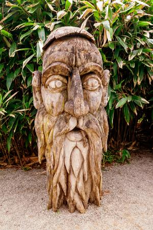MAINAU, GERMANY - APRIL 15, 2018: Old wooden sculpture at Mainau island , Lake Constance, Germany,Europe Editorial