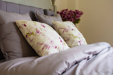 bed linen: Vintage style pillows on a bed. Stock Photo