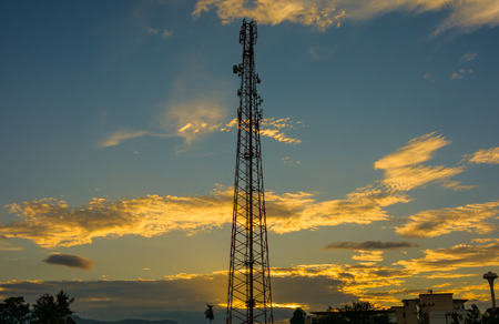 cell phone tower in sunset.