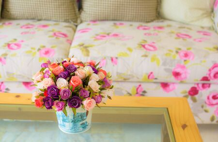 Colorful flowers in living room. photo