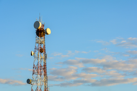 通信: Telecomunications tower in sunset light.