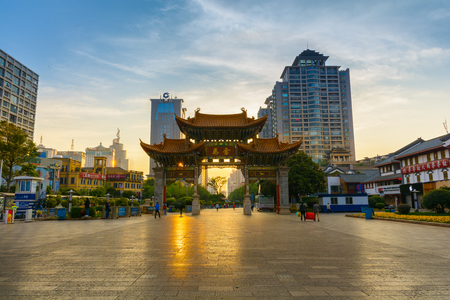 KUNMING-MARCH 15, 2015. Illuminated arches downtown, The golden horse gate in morning light. Editorial