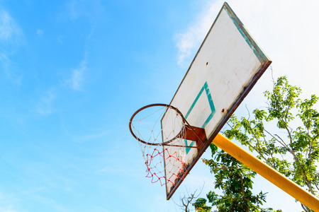 Old basketball backboard at outdoor street court.