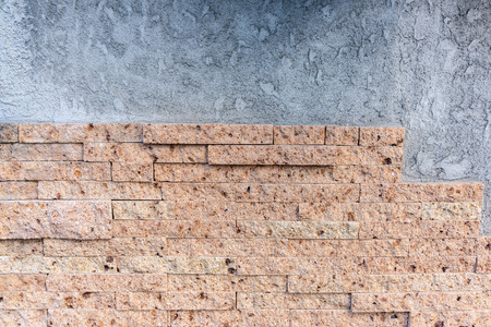 Old vintage retro style weathered bricks or stone wall background and texture