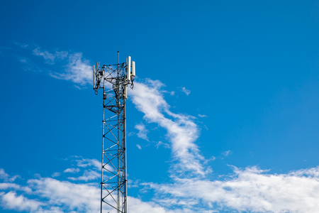 Cell phone tower with blue sky background