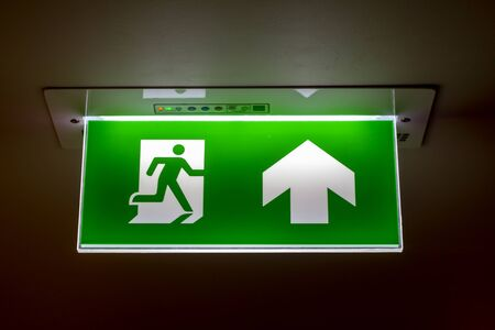The real safety green sign symbol for go to the fire exit