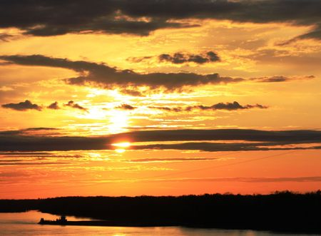 Sunset over Mississippi river photo