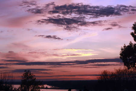 Sunset with purple and pink hues in the sky photo