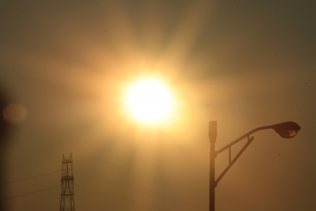 sweltering: Golden sunset over streetlight and power lines Stock Photo