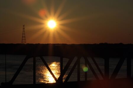 Sunset across Mississippi River bridge photo