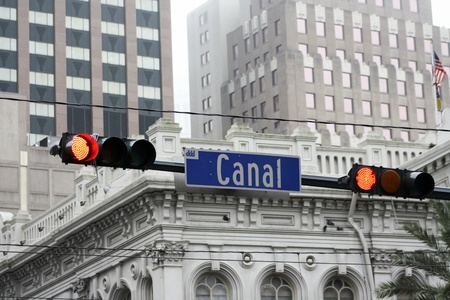 Canal Street stoplight with buildings in the background