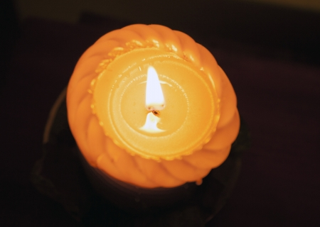 Orange candle burning form the top
