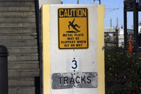 Caution sign and tracks sign photo