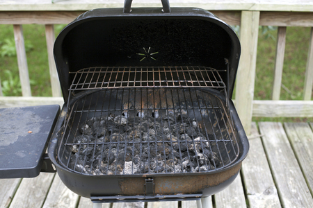 Dirty barbecue pit with remnants of old charcoal Stock Photo