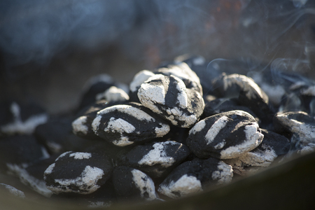 briquettes: Smoking charcoal with small flame