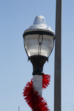 Christmas garland wrapped around lamp pole Stock Photo