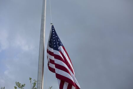 a memorial to fallen soldiers: American flag at half mast for mourning and holidays Stock Photo