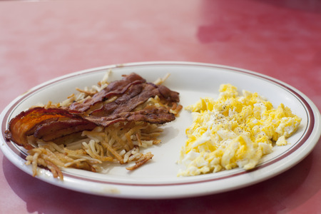 hashbrowns: Breakfast plate of bacon, eggs and hashbrowns