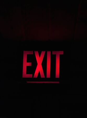 Close up of a glowing red exit sign