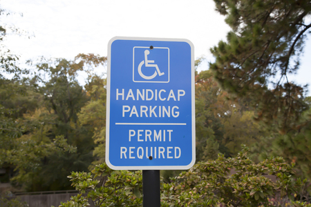 Close up of a blue accessible handicap parking sign