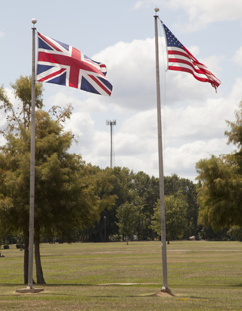 British and American flags flapping proudly in the wind