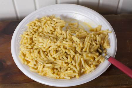 Close up of a large plate of baked macaroni and cheese