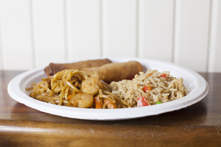 Heavy meal of spring rolls, shrimp lo mein, fried rice and sweet and sour sauce