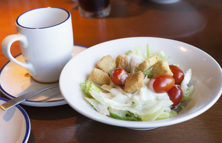 ranch background: Bowl filled with garden salad topped with ranch dressing