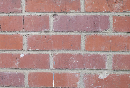 Patch of dirty red bricks in a wall