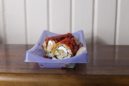 Close up of a roll of spicy shrimp tempura sushi