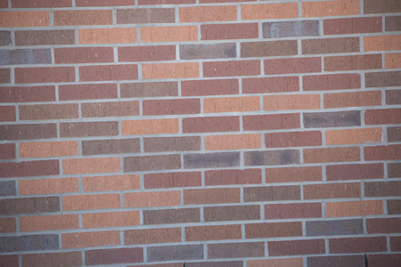 Close up of a section of red brick wall