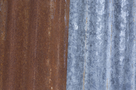 grooves: Red and silver retro aluminum siding on a barn